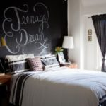 Eclectic-bedroom-with-a-chalkboard-paint-wall-behind-the-headboard